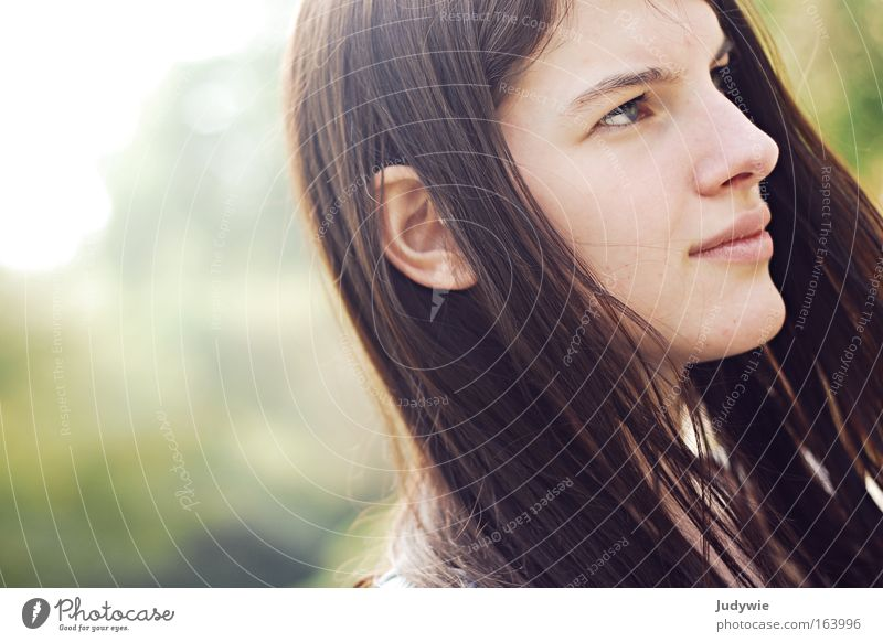 Concentration. Colour photo Exterior shot Copy Space left Day Light Sunlight Portrait photograph Profile Forward Human being Feminine Young woman