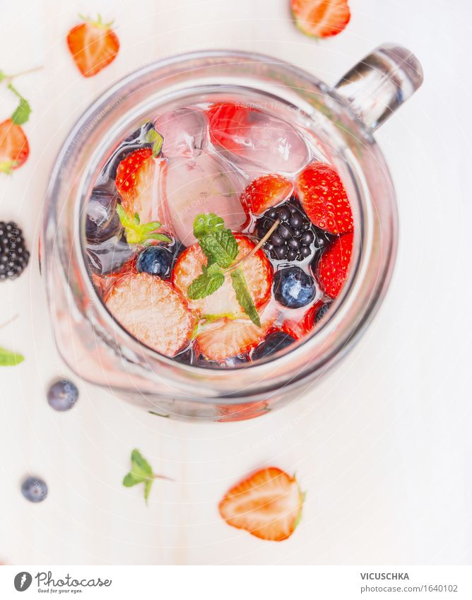 Jug with berries water and ice cubes Food Fruit Beverage Cold drink Drinking water Juice Crockery Style Design Healthy Eating Athletic Fitness Life Summer Water