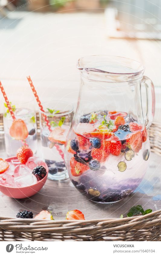 jug with water, berries and ice cubes on the garden table Food Fruit Beverage Cold drink Lemonade Juice Glass Style Design Healthy Eating Life Summer