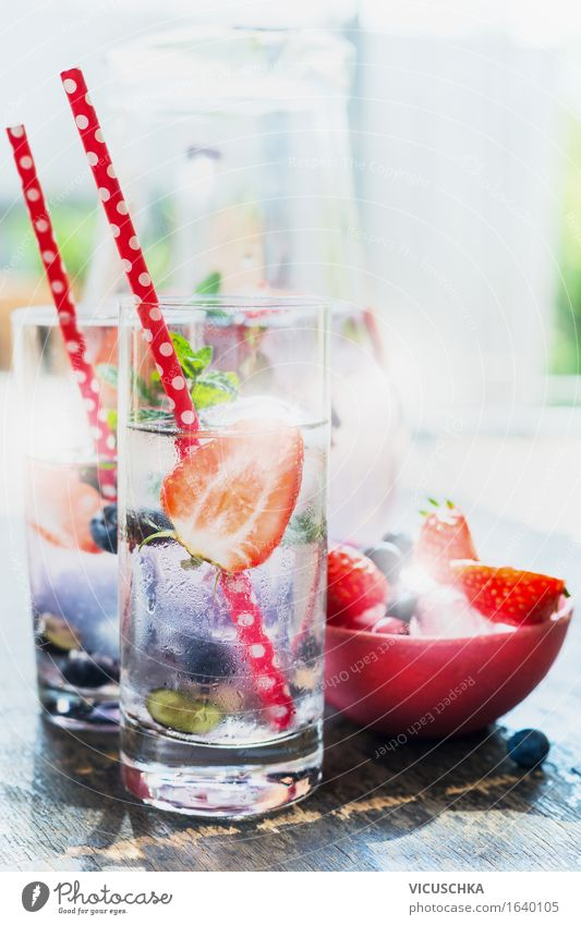 glasses with berries lemonade , red straw and ice cubes Food Fruit Beverage Cold drink Lemonade Juice Longdrink Cocktail Glass Straw Lifestyle Healthy Eating