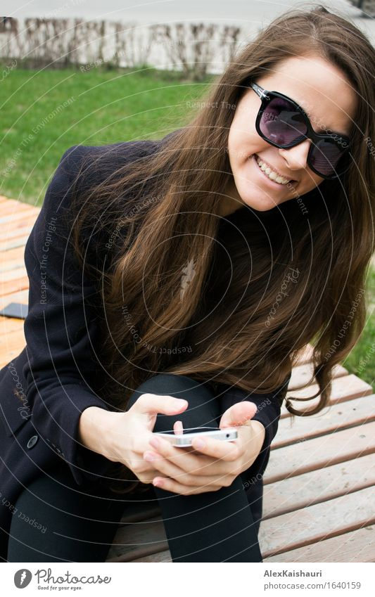 Beautiful business woman with cell phone is laughing Lifestyle Elegant Style SME Career Success Meeting Cellphone Young woman Youth (Young adults) 1 Human being