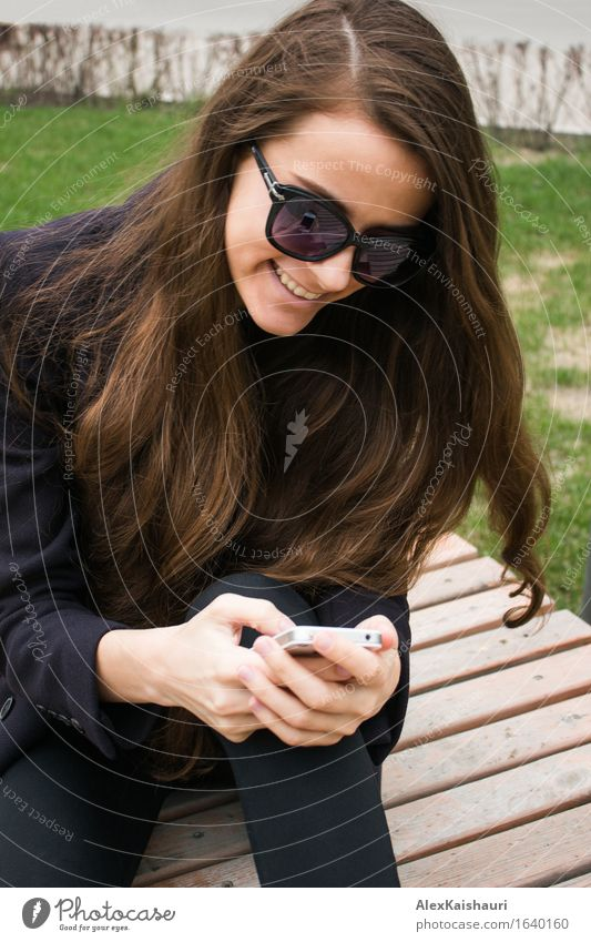 Beautiful business woman with cell phone is laughing Human being Youth (Young adults) City Summer Young woman Joy 18 - 30 years Adults Spring Emotions Style