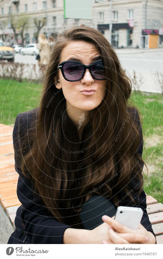 Business woman in a park making faces. Human being Youth (Young adults) City Beautiful Summer Young woman Joy 18 - 30 years Face Adults Emotions Feminine Style Lifestyle Playing Park