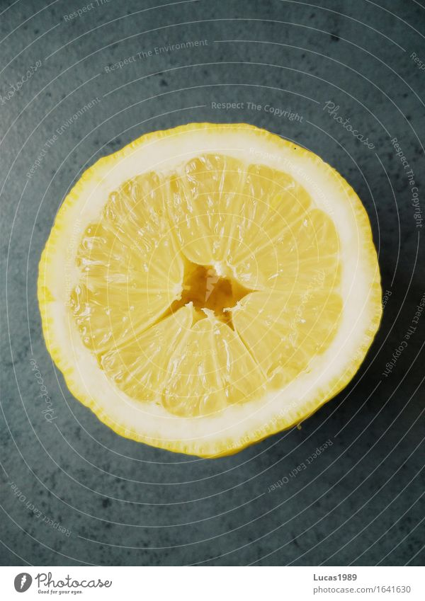 Lemon in cross section Food Fruit Citrus fruits Lime Orange Nutrition Organic produce Vegetarian diet Vitamin C Vitamin-rich Healthy Yellow Gray White