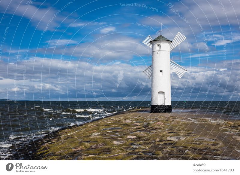 Mole in Swinemünde in Poland Vacation & Travel Tourism Waves Nature Landscape Water Clouds Coast Baltic Sea Tower Lighthouse Architecture Landmark Stone Blue