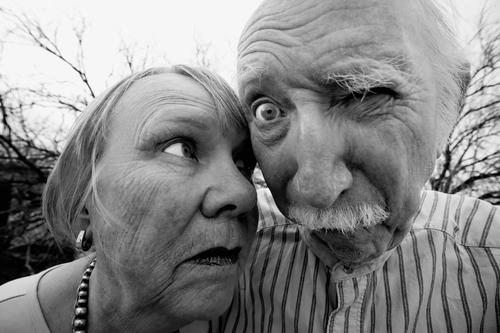 Crazy man and woman Black & white photo Exterior shot Day Wide angle Portrait photograph Front view Looking Looking into the camera Forward Human being