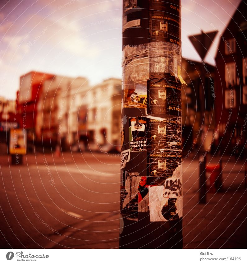 communication column Lomography Holga Sightseeing Hamburg Deserted Lamp post Characters Signs and labeling Broken Town Dirty Piece of paper Stick Street