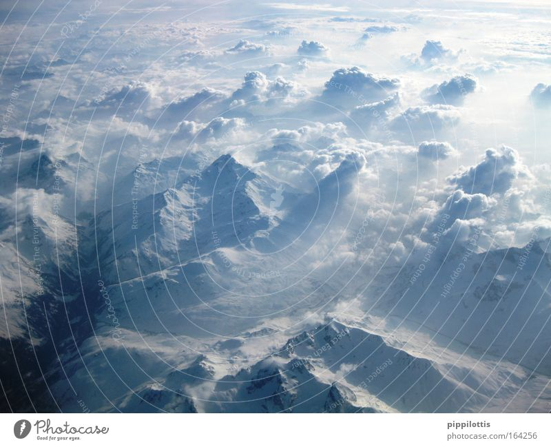 above the clouds Colour photo Exterior shot Aerial photograph Deserted Day Light Sunlight Sunbeam Bird's-eye view Panorama (View) Wide angle Vacation & Travel