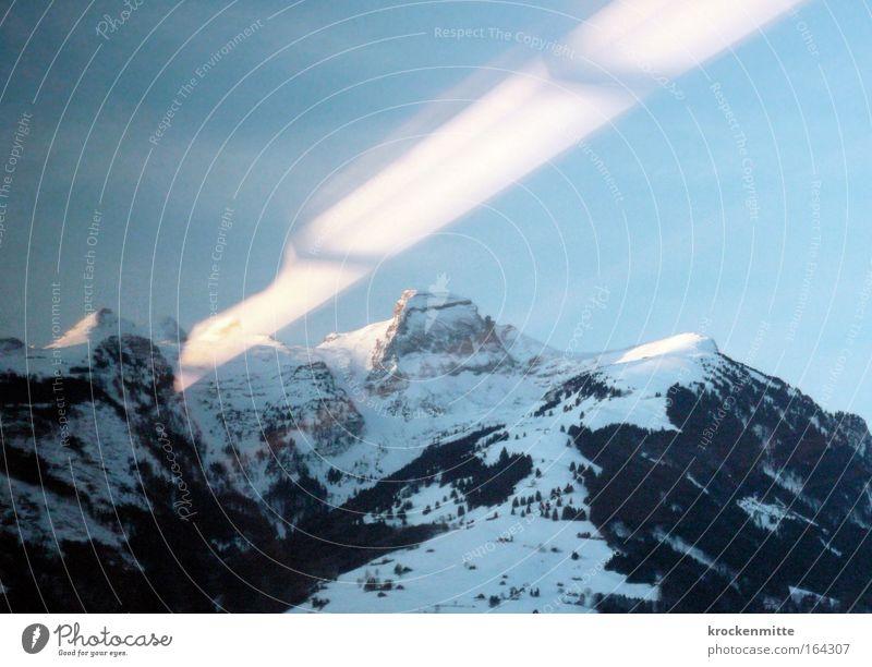 UFO SIGHTING IN SWITZERLAND? Colour photo Exterior shot Morning Light Sunlight Sunbeam Nature Landscape Elements Alps Mountain Peak Snowcapped peak Stone Blue
