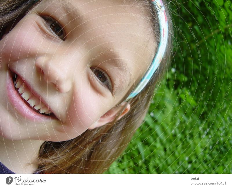 I'm so happy. Child Girl Meadow Laughter Happiness Green Colour photo Exterior shot Detail Copy Space right Central perspective Looking into the camera