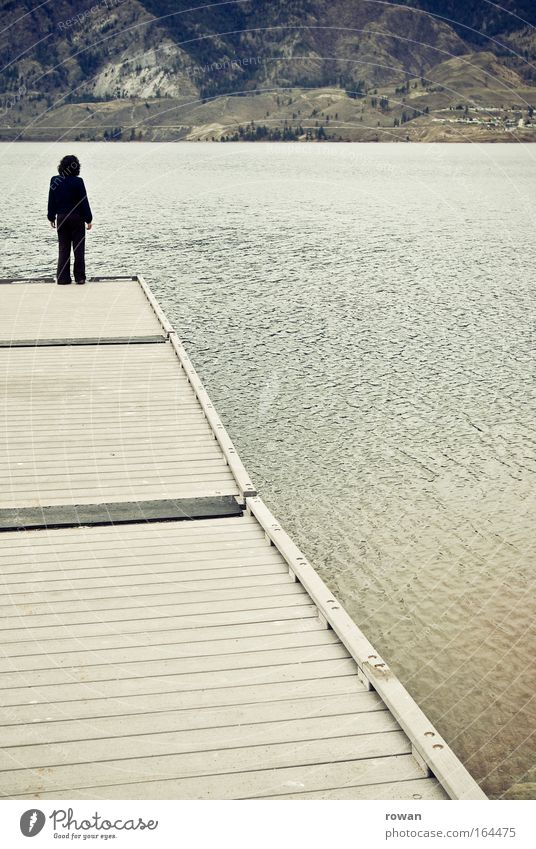 footbridge Colour photo Subdued colour Exterior shot Day Full-length Rear view Human being 1 Water Coast Lakeside Think Stand Gloomy Dream Distress Calm Looking