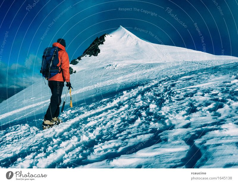 Mountaineer climbs a snowy peak. Human being Vacation & Travel Man Landscape Loneliness Snow Sports Hiking Power Success Walking Europe Adventure Climbing
