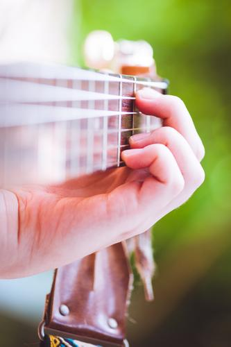 piecework Hand Music Concert Outdoor festival Singer Musician Guitar Musical instrument acoustic guitar Classical Study Playing Retro Green Passion Diligent