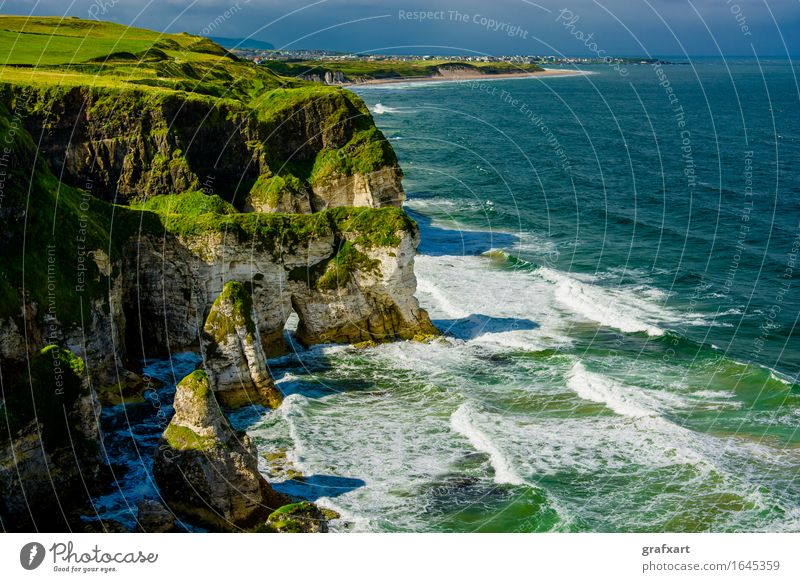 Coast with cliffs at Portrush in Northern Ireland Cliff Atlantic Ocean Landscape Waves Vantage point Surf Rock Rocky coastline House (Residential Structure)