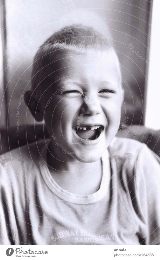 Toothless Laugh Black & white photo Interior shot Day Portrait photograph Upper body Looking Looking into the camera Masculine Child Boy (child) Face Mouth