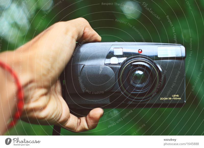 analog camrea Lifestyle Style Design Leisure and hobbies Camera Technology Plastic Utilize Touch To hold on Playing Old Retro Black Hand Fingers Vintage Analog