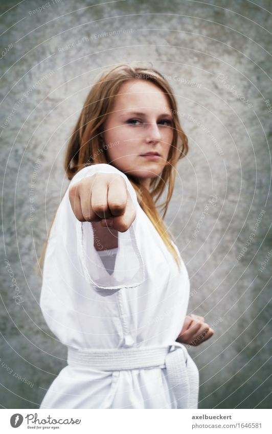 Human being Youth (Young adults) Young woman 18 - 30 years Adults Feminine Sports Leisure and hobbies Power Fitness Strong Sports Training Fist Martial arts
