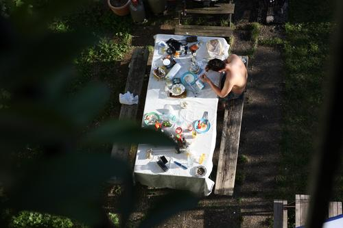 Human being Youth (Young adults) Summer Young man Relaxation Eating Garden Moody Contentment Leisure and hobbies Idyll Table To enjoy Joie de vivre (Vitality)