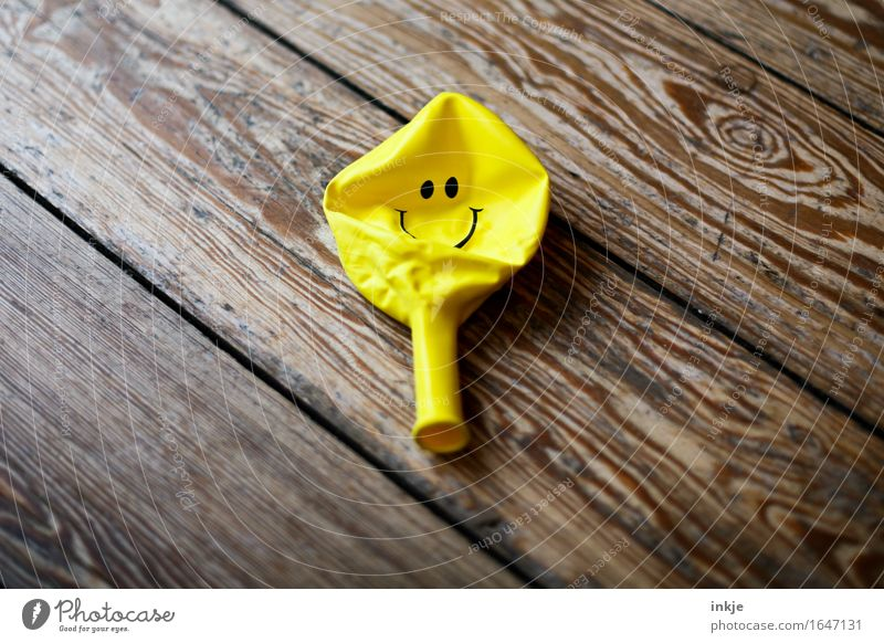 The air's out. (After the opening... Balloon Sign Smiley Smiling Lie Happiness Happy Positive Yellow Emotions Moody Joy Contentment Optimism Proverb Optimist