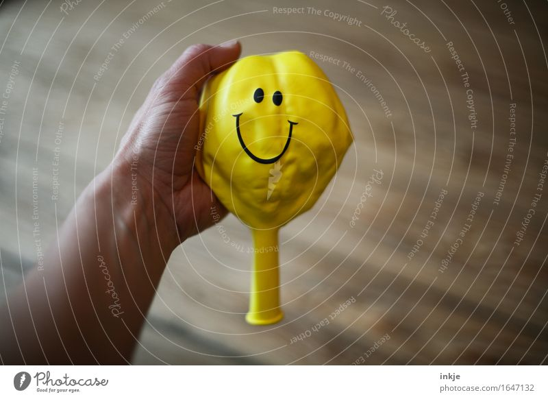 optimist Lifestyle Joy Hand Balloon Sign Smiley Smiling Friendliness Happiness Positive Yellow Emotions Moody Contentment Optimism Indicate Wrinkles Level