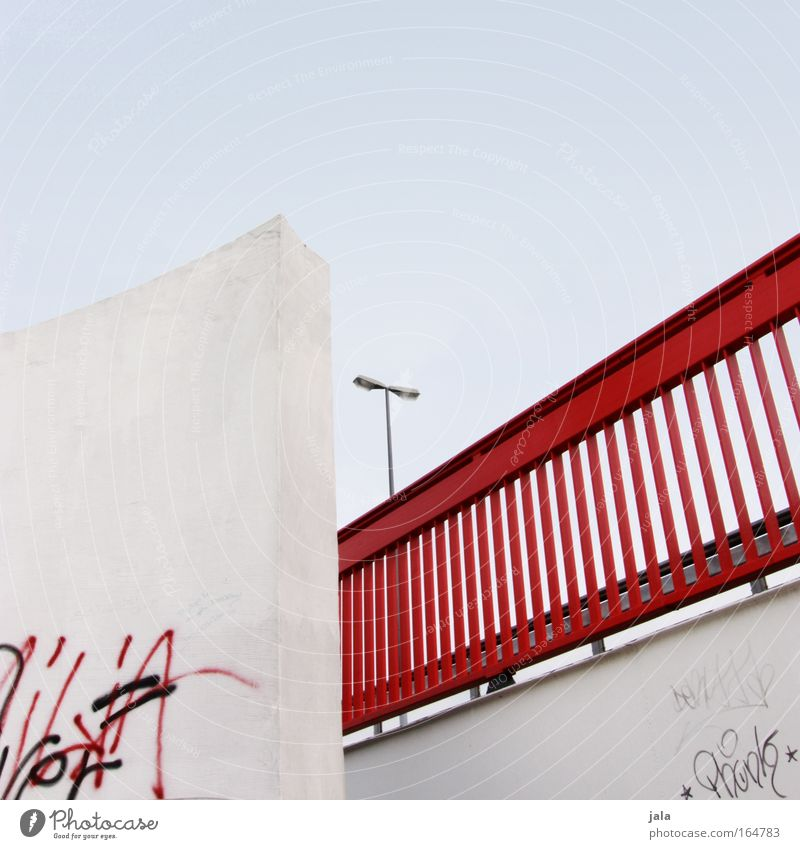 red rail Colour photo Exterior shot Deserted Day Light Cloudless sky Bridge Manmade structures Wall (barrier) Wall (building) Street lighting Handrail Blue Red