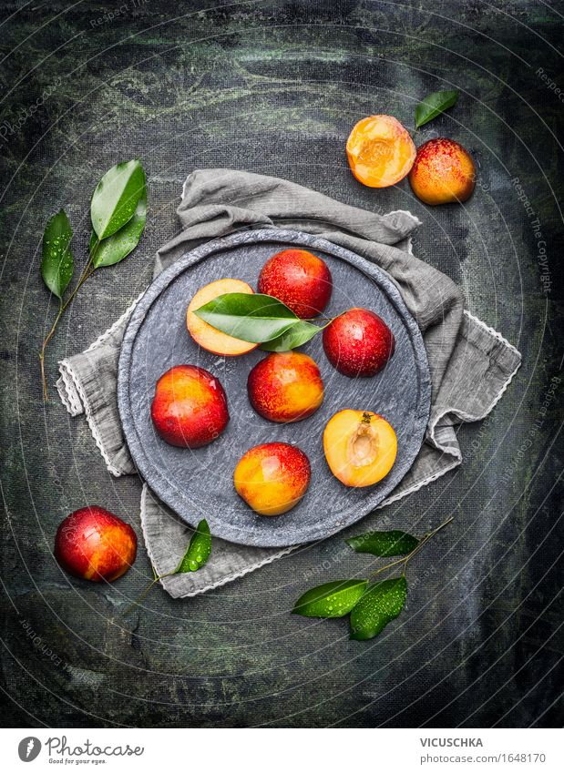 Halved peaches with leaves Food Fruit Nutrition Organic produce Vegetarian diet Crockery Plate Style Design Healthy Eating Life Table Summer Peach Nectarine