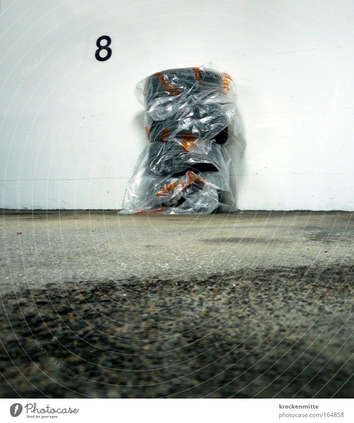 Wall (building) Gray Wall (barrier) Road traffic Digits and numbers Parking lot 8 Stack Tire tread Parking garage Packaging Rubber Packaged Parking space number