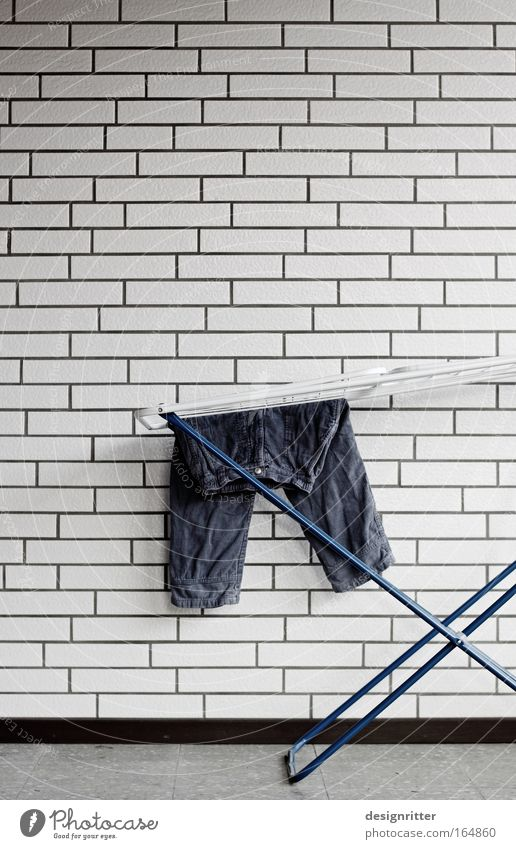 House (Residential Structure) Wall (building) Wall (barrier) Infancy Work and employment Power Flat (apartment) Stand Living or residing Clean Dry Pants Strong Fatigue Hang Washing