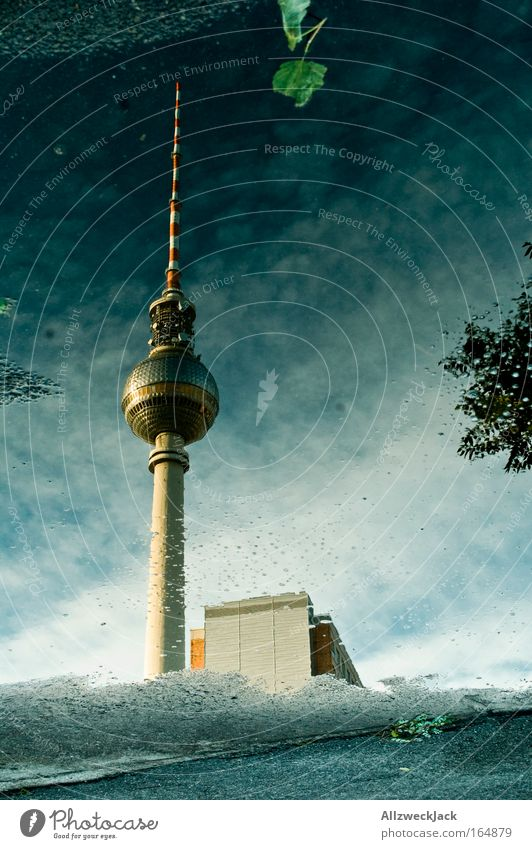 City Berlin Large Authentic Telecommunications Uniqueness Exterior shot Storm Landmark Downtown Water Puddle Berlin TV Tower Capital city Famousness