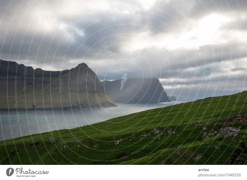 Landscape on the Faroe Islands as seen from Vidareidi Sun Ocean Mountain Hiking Grass Meadow Rock River Stone Green Emotions intense Dramatic mood positive