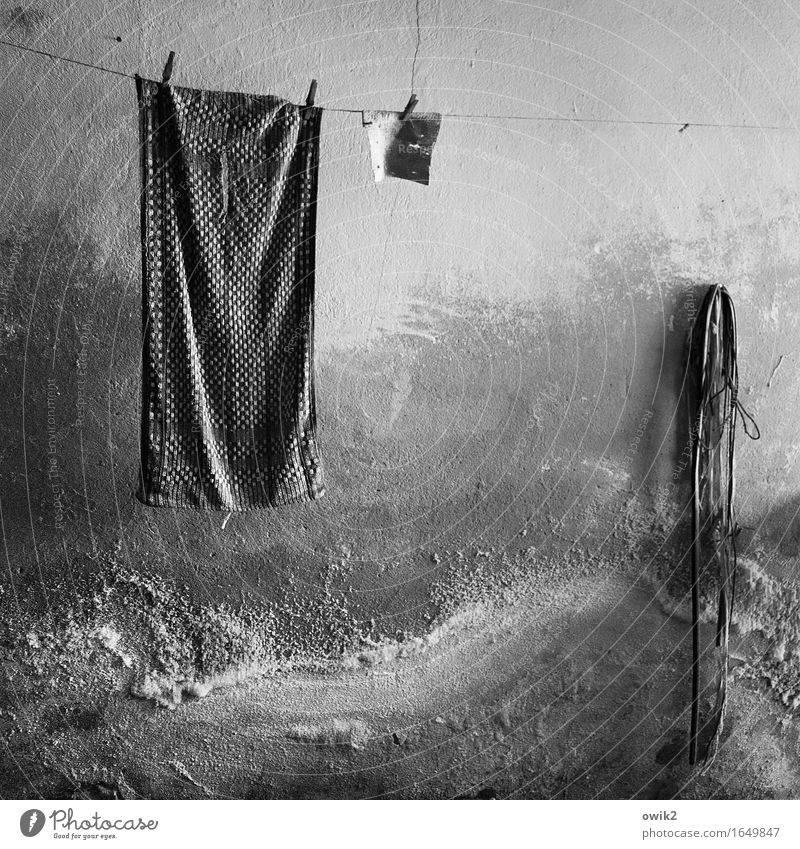 stuck Wall (barrier) Wall (building) Facade Clothesline Towel Rope Clothes peg Hang Old Dark Together Trashy Gloomy Dry Serene Patient Calm Decline Transience