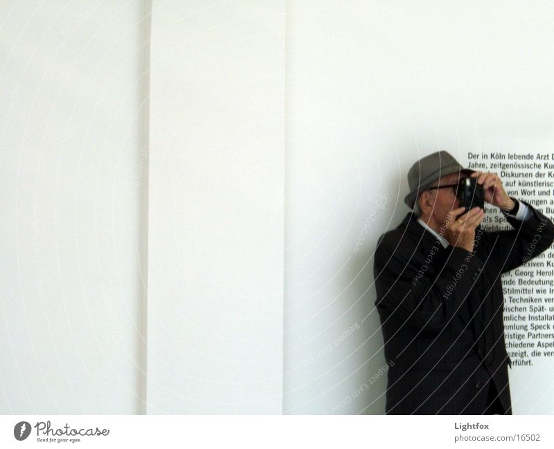 Grandpa photographed Take a photo Text Photography Wall (building) Human being Old Museum old opi Camera