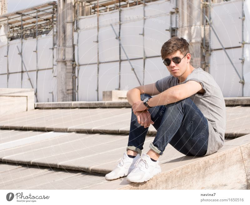 He sits Masculine Young man Youth (Young adults) Brother 1 Human being 13 - 18 years Fashion T-shirt Jeans Sunglasses Sneakers Observe Crouch Free Athletic