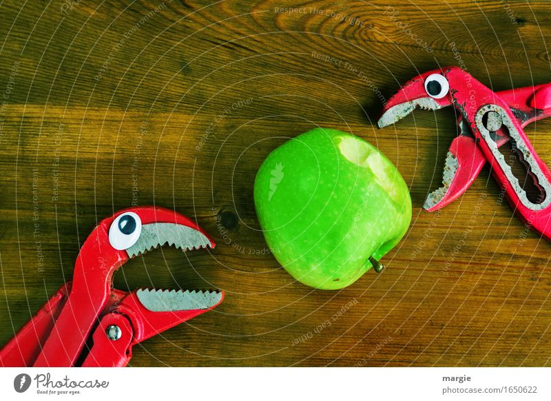 ...tastes good, take a bite! Two pincers with eyes biting into a green apple Food Fruit Apple Organic produce Diet Craftsperson Workplace Construction site