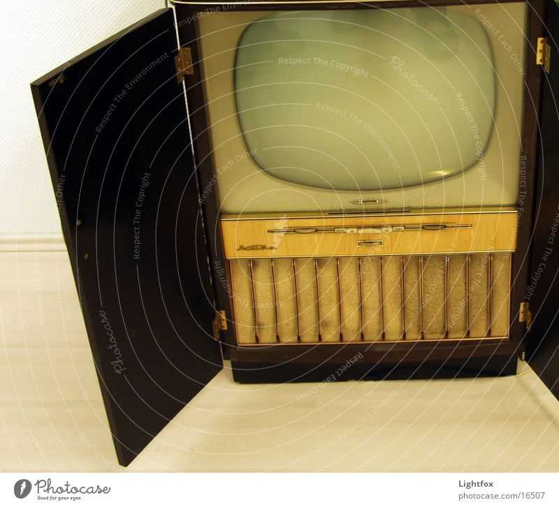 Watch TV! TV set The fifties Sixties Cuba Ancient Television Wood Wood flour Human being Shows Media Old Technology Net