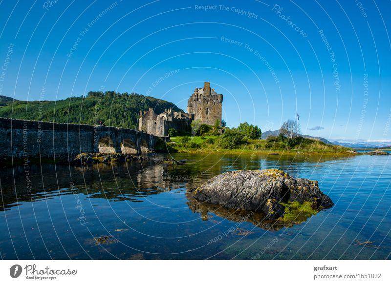 Eilean Donan Caste in Scotland Eilean Donan castle Castle Building Fortress Bridge Water Lake Hollow Rock Sky Old clan Past Great Britain Picturesque Landscape