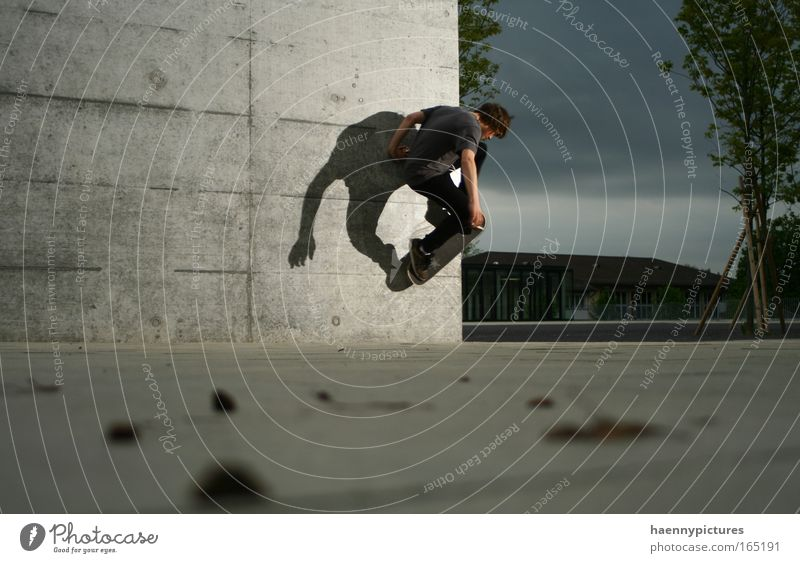 Youth (Young adults) Adults Gray Individual Skateboarding Shadow play Dexterity 1 Person Concrete wall Light and shadow Only one man One young adult man