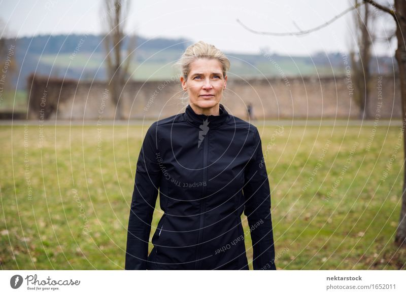 portrait of healthy woman in park Lifestyle Winter Human being Woman Adults Park Blonde Observe Think Stand Athletic Black Considerate attractive Mature Earnest