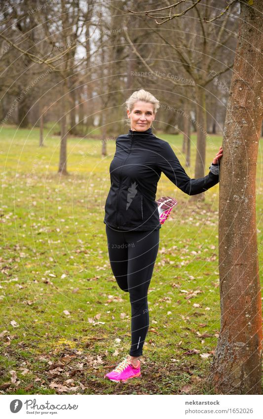 woman stretching in park Lifestyle Body Wellness Sports Human being Woman Adults Park Fitness Smiling Stand Athletic Thin Friendliness limbering up Musculature