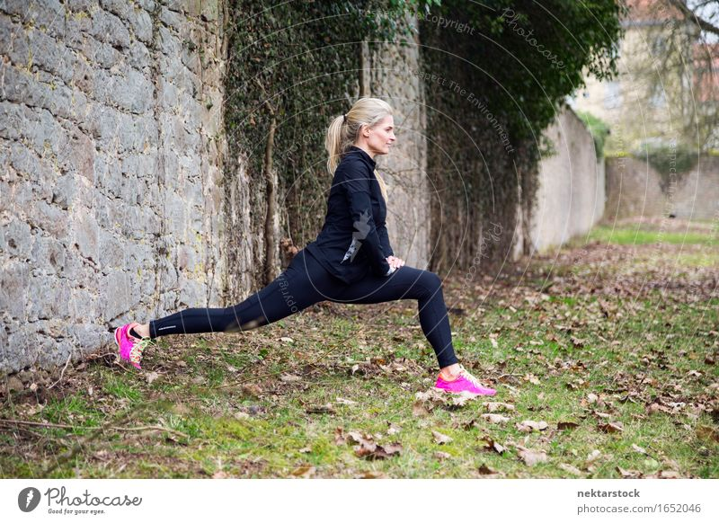 attractive blonde woman exercising in park Lifestyle Body Wellness Sports Human being Woman Adults Park Fitness Athletic Thin Muscular Practice healthy workout