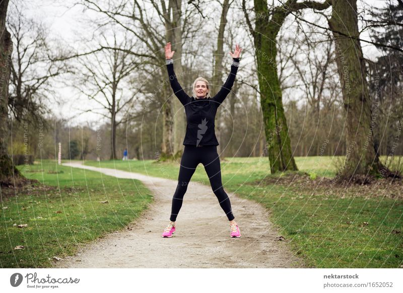 woman exercising on winter day Lifestyle Joy Happy Body Wellness Sports Human being Woman Adults Arm Tree Park Fitness Smiling Jump Athletic Practice healthy
