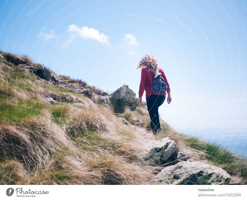 Woman walks on a mountain path in a sunny day. Human being Nature Vacation & Travel Summer Landscape Mountain Adults Life Sports Hiking Adventure Wellness