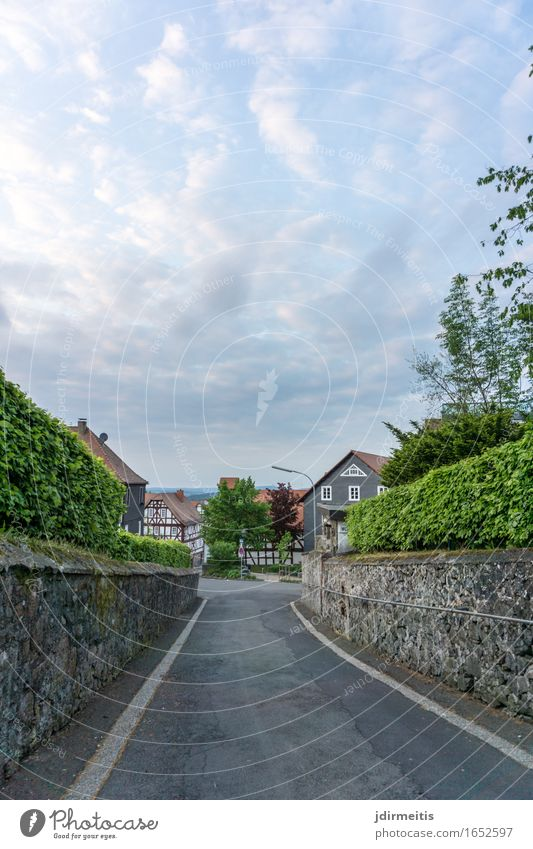 Sky Vacation & Travel Landscape Clouds House (Residential Structure) Environment Street Architecture Wall (building) Building Wall (barrier) Going Castle