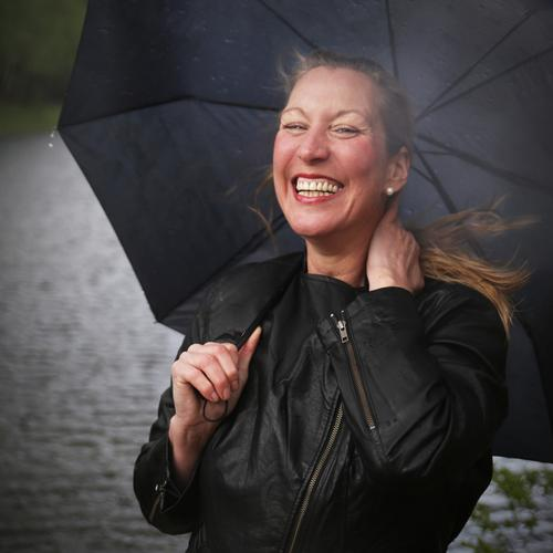 Yvonne Feminine 1 Human being Rain Waves Coast Jacket Umbrella Blonde Long-haired Observe Relaxation Laughter Looking Wait natural already Wild Emotions