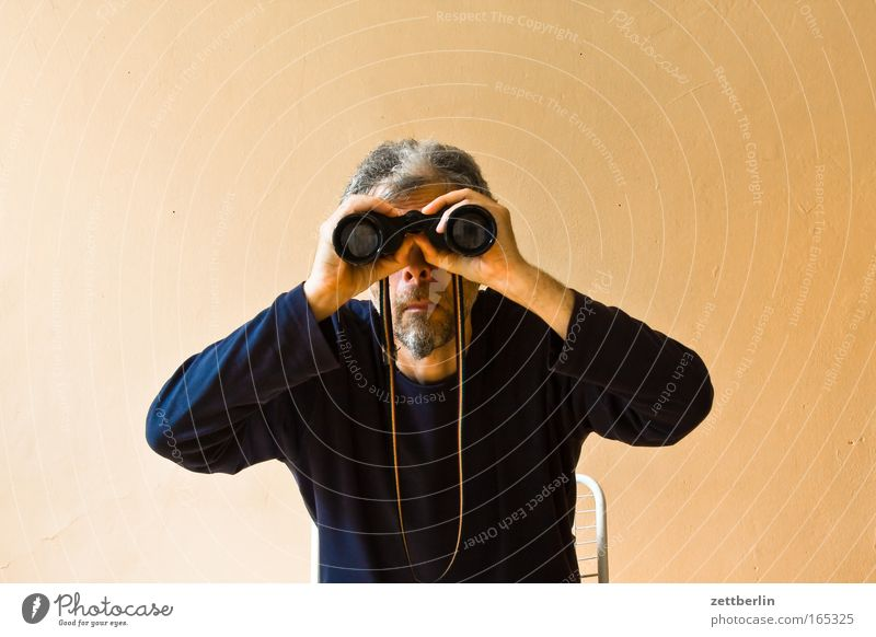 search Binoculars Telescope Search Perspective Opinion Far-off places Vantage point search function Man Senior citizen Old Sit Seating Chair Observe Looking
