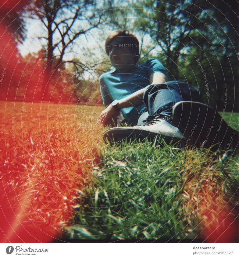 Human being Nature Youth (Young adults) Blue Green Tree Red Summer Adults Relaxation Meadow Grass Park Footwear Masculine Lie