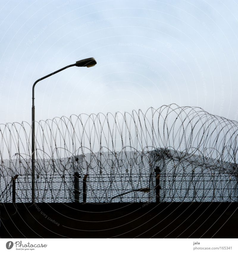 Blue Black Loneliness Wall (building) Building Wall (barrier) Fear Closed Lantern Force Captured Criminality Fortress Jail sentence Barbed wire