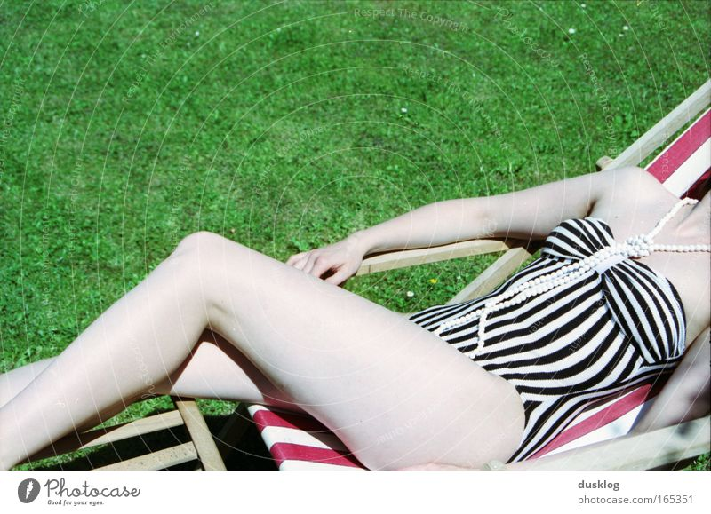 Human being Youth (Young adults) Beautiful Vacation & Travel Summer Ocean Calm Relaxation Feminine Style Legs Fashion Lie Stripe Wellness Swimming pool