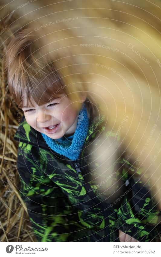 Human being Child Joy Face Yellow Emotions Funny Boy (child) Playing Laughter Happy Masculine Contentment Gold Sit Authentic
