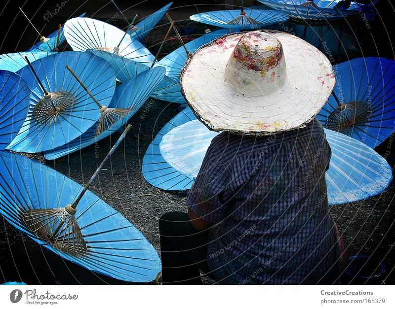 Umbrellas in Thailand Colour photo Exterior shot Copy Space left Day Rear view Looking away Lifestyle Workplace Factory Human being 1 Artist Painter Work of art
